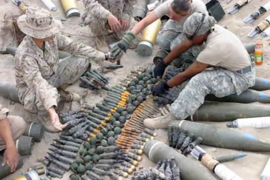 US Marines From The Ammunition Detachment Combat Logistics Regiment 15 1st Marine Group Forward Prepare Ordnance For Detonation As Part Of